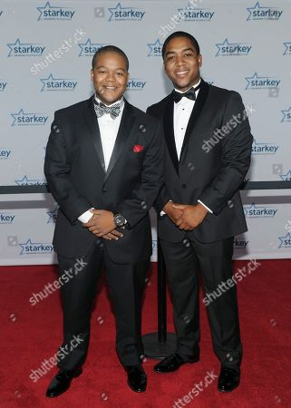 """Kyle and Chris Massey are seen walking the red carpet at the Starkey Hearing Foundation's 2013 """"So the World May Hear"""" Awards Gala, on in St. Paul, Minn"""