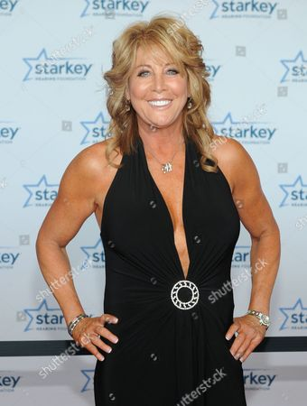 """Nancy Lieberman is seen walking the red carpet at the Starkey Hearing Foundation's 2013 """"So the World May Hear"""" Awards Gala, on in St. Paul, Minn"""
