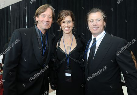 """Kevin Sorbo and wife Sam Jenkins pose for a photo with Doug Pitt at the Starkey Hearing Foundation's 2013 """"So the World May Hear"""" Awards Gala, on in St. Paul, Minn"""