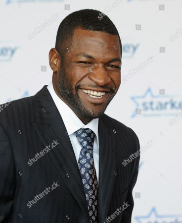 """Mark Clayton is seen walking the red carpet at the Starkey Hearing Foundation's 2013 """"So the World May Hear"""" Awards Gala, on in St. Paul, Minn"""