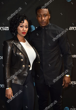 Stock Picture of Michi Marshall, left, and Brandon Marshall arrive at DIRECTV Super Saturday Night at Pier 70, in San Francisco, Calif