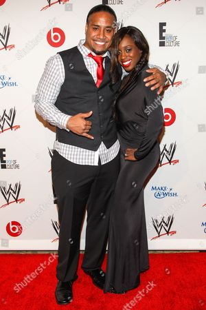 From left, WWE Superstars Jonathan Fatu (AKA Jimmy Uso) and Trinity McCray (AKA Naomi) arrive at the Superstars of Hope honors Make A Wish Foundation event at The Beverly Hills Hotel on in Beverly Hills, Calif