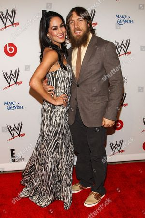 From left, WWE Superstars Brianna Garcia-Colace (AKA Brie Bella) and Bryan Danielson (AKA Daniel Bryan) arrives at the Superstars of Hope honors Make A Wish Foundation event at The Beverly Hills Hotel on in Beverly Hills, Calif