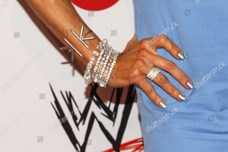 WWE ring announcer Lilian Garcia (jewelry detail) arrives at the Superstars of Hope honors Make A Wish Foundation event at The Beverly Hills Hotel on in Beverly Hills, Calif