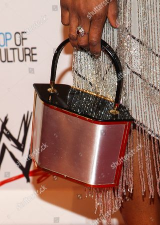 WWE Superstar Victoria Crawford (AKA Alicia Fox) (purse detail) arrives at the Superstars of Hope honors Make A Wish Foundation event at The Beverly Hills Hotel on in Beverly Hills, Calif