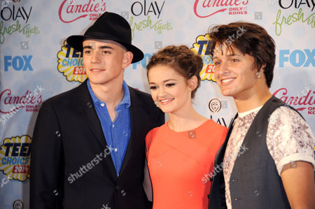 Stock Image of Charlie Rowe, and from left, Ciara Bravo and Nolan Sotillo pose in the press room at the Teen Choice Awards at the Shrine Auditorium, in Los Angeles