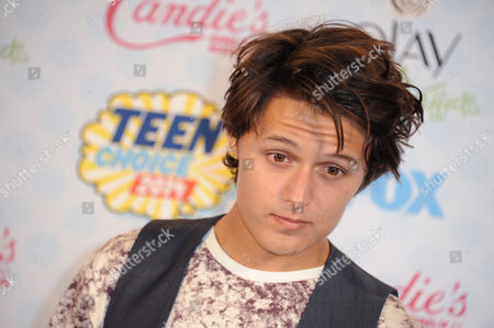 Nolan Sotillo poses in the press room at the Teen Choice Awards at the Shrine Auditorium, in Los Angeles