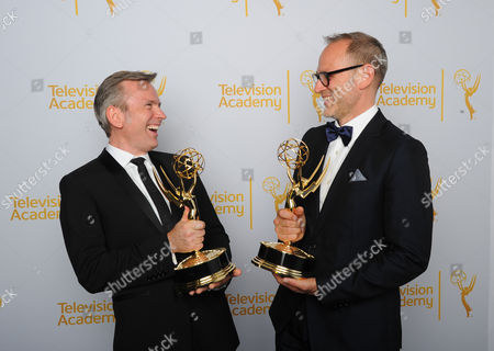 Eric Justian, left, and Tom Broecker pose for a portrait at the Television Academy's Creative Arts Emmy Awards at the Nokia Theater L.A. LIVE, in Los Angeles