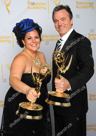 Gloria Lamb, left, and Derek McLane pose for a portrait at the Television Academy's Creative Arts Emmy Awards at the Nokia Theater L.A. LIVE, in Los Angeles