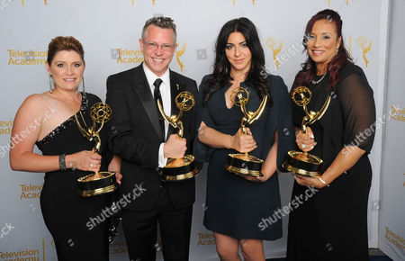 Daina Daigle, and from left, Monte C Haught, Michelle Ceglia and Yolanda Mercadel pose for a portrait at the Television Academy's Creative Arts Emmy Awards at the Nokia Theater L.A. LIVE, in Los Angeles