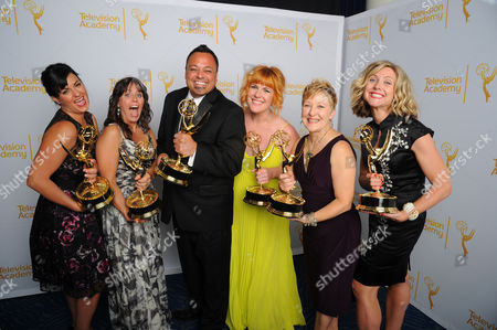 Jodi Mancuso, and from left, Bettie O. Rogers, Joe Whitmeyer, Jennifer Serio Stauffer, Inga Thrasher and Cara Hannah Sullivan pose for a portrait at the Television Academy's Creative Arts Emmy Awards at the Nokia Theater L.A. LIVE, in Los Angeles