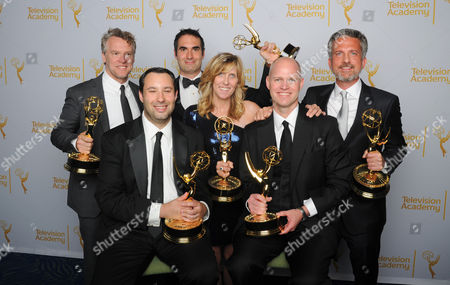 Tate Donovan, and from left, Dan Silver, Connor Schell, Maura Manat, John Dahl, and Bill Simmons pose for a portrait at the Television Academy's Creative Arts Emmy Awards at the Nokia Theater L.A. LIVE, in Los Angeles