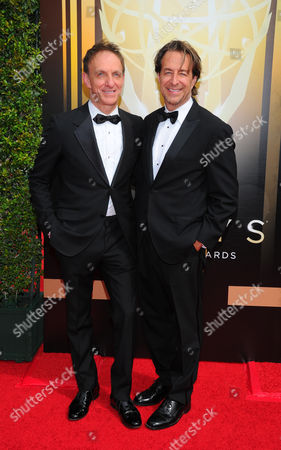 Mychael Danna, left, and Jeff Danna arrive at the Television Academy's Creative Arts Emmy Awards at Microsoft Theater, in Los Angeles