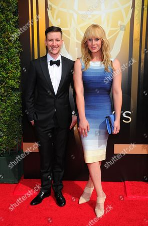 Rhys Ernst, left, and Zackary Drucker arrive at the Television Academy's Creative Arts Emmy Awards at Microsoft Theater, in Los Angeles