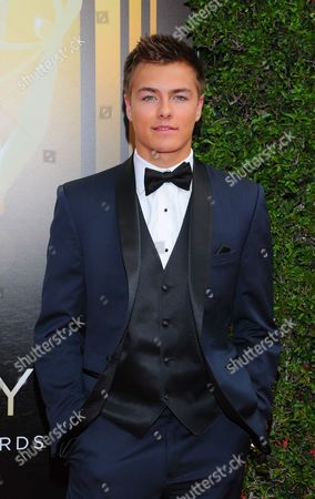 Peyton Meyer arrives at the Television Academy's Creative Arts Emmy Awards at Microsoft Theater, in Los Angeles