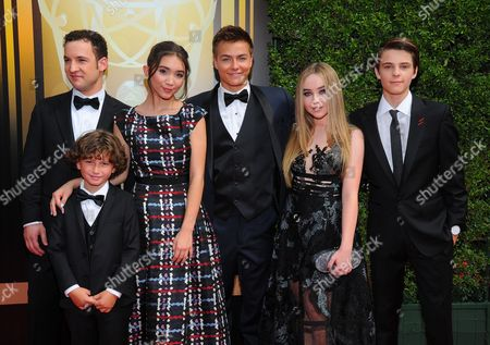Ben Savage, from left, August Maturo, Rowan Blanchard, Peyton Meyer, Rowan Blanchard, Peyton Meyer, Sabrina Carpenter, and Corey Fogelmanis arrive at the Television Academy's Creative Arts Emmy Awards at Microsoft Theater, in Los Angeles