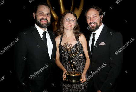 "Tyler B. Robinson, from left, Katherine Isom and Schuyler Telleen pose backstage with the outstanding production design for variety nonfiction, reality or reality competition programming award for ""Portlandia"" at the Television Academy's Creative Arts Emmy Awards at Microsoft Theater, in Los Angeles"