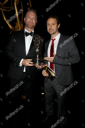 "Kyle Dunnigan, left, and Jim Roachthe pose backstage, winners of the outstanding original music and lyrics award for ""Inside Amy Schumer"" at the Television Academy's Creative Arts Emmy Awards at Microsoft Theater, in Los Angeles"