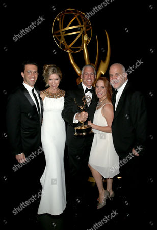 """Adam Lewinson, from left, Tava Smiley, Brian Katkin, Maureen Timpa and Chuck Saftler pose backstage, winners of the award for outstanding short format nonfiction program for """"A Tribute to Mel Brooks"""" at the Television Academy's Creative Arts Emmy Awards at Microsoft Theater, in Los Angeles"""