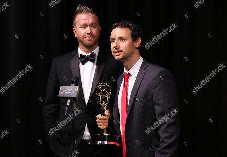 "Jim Roachthe, left, and Kyle Dunnigan participate in an interview with the outstanding original music and lyrics award for ""Inside Amy Schumer"" at the Television Academy's Creative Arts Emmy Awards at Microsoft Theater, in Los Angeles"