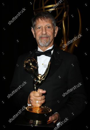 Peter Coyote poses backstage with the outstanding narrator award for The Roosevelts: An Intimate History at the Television Academy's Creative Arts Emmy Awards at Microsoft Theater, in Los Angeles