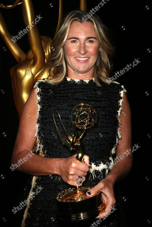 Nancy Dubuc, winner of the Governor's Award, poses backstage at the Television Academy's Creative Arts Emmy Awards at Microsoft Theater, in Los Angeles