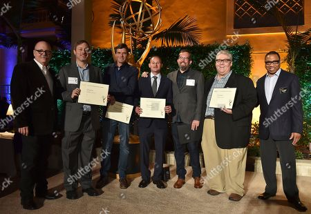 """Tim Gibbons, from left, Lew Morton, Morgan Sackett, David Hyman, Erik Kenward, David Mandel and Hayma """"Screech"""" Washington attend the Television Academy's 2016 Producers Nominee Reception at the Montage Hotel, in Beverly Hills, Calif"""