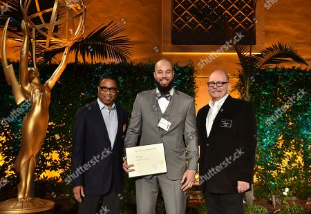 """Hayma """"Screech"""" Washington, from left, Peter Saji and Tim Gibbons attend the Television Academy's 2016 Producers Nominee Reception at the Montage Hotel, in Beverly Hills, Calif"""