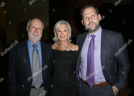 """Stock Picture of James Burrows, from left, Laurie Burrows Grad and Nicholas Grad arrive at the 24th annual Alzheimer's Association """"A Night at Sardi's"""" at the Beverly Hilton hotel, in Beverly Hills, Calif"""