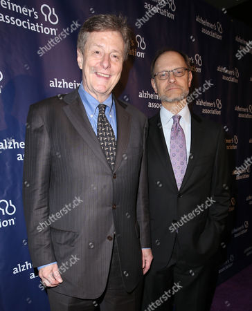 """Brian Hargrove and David Hyde Pierce arrive at the 24th annual Alzheimer's Association """"A Night at Sardi's"""" at the Beverly Hilton hotel, in Beverly Hills, Calif"""
