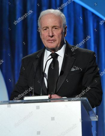 Jerry Weintraub accepts the award for outstanding producer of non-fiction television for Behind the Candelabra at the 25th annual Producers Guild of America (PGA) Awards at the Beverly Hilton Hotel, in Beverly Hills, Calif