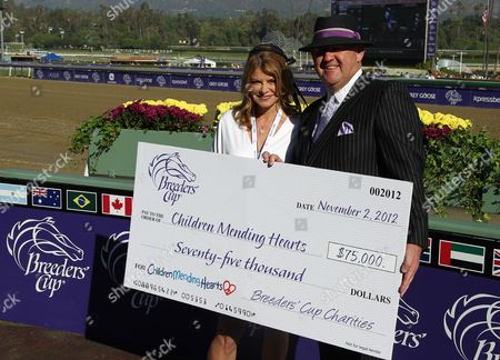 IMAGE DISTRIBUTED FOR BREEDERS' CUP - Lysa Heslov, left, and Breeders' Cup COO Bob Elliston are seen on Day 2 of the Breeders' Cup World Championships, in Arcadia, Calif