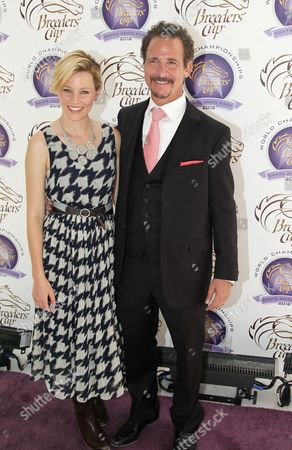 Elizabeth Banks and Jim Rome are seen on Day 2 of the Breeders' Cup World Championships, in Arcadia, Calif