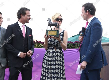 Jim Rome and Elizabeth Banks are seen on Day 2 of the Breeders' Cup World Championships, in Arcadia, Calif