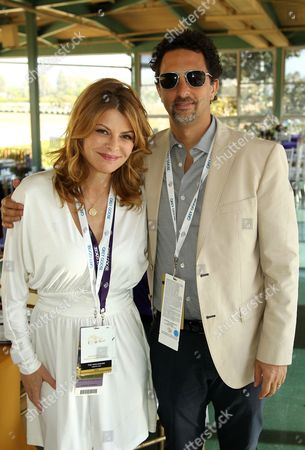 IMAGE DISTRIBUTED FOR BREEDERS' CUP - Lysa Heslov, left, and Grant Heslov are seen on Day 2 of the Breeders' Cup World Championships, in Arcadia, Calif