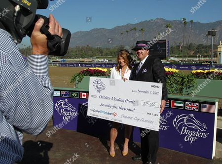 Lysa Heslov and Breeders' Cup COO Bob Elliston are seen on Day 2 of the Breeders' Cup World Championships, in Arcadia, Calif