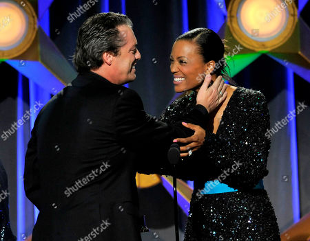 "Aisha Tyler, right presents the game show host award for ""Family Game Night"" to Todd Newton onstage at the 39th Annual Daytime Emmy Awards on HLN at the Beverly Hilton Hotel on in Beverly Hills, Calif"