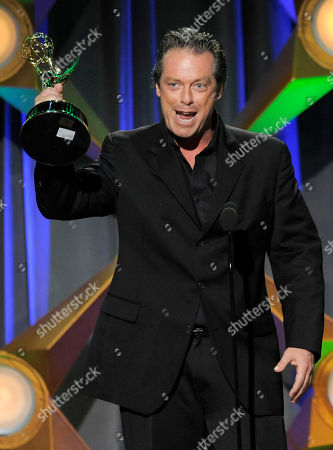 "Todd Newton accepts the game show host award for ""Family Game Night"" onstage at the 39th Annual Daytime Emmy Awards at the Beverly Hilton Hotel on in Beverly Hills, Calif"