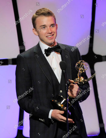 """Chandler Massey accepts the award for outstanding younger actor for """"Days of our Lives"""" onstage at the 39th Annual Daytime Emmy Awards on HLN at the Beverly Hilton Hotel on in Beverly Hills, Calif"""