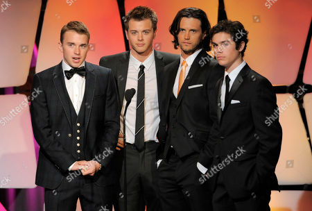 From left, Chandler Massey, Chad Duell, Nathan Parsons and Eddie Alderson present an award onstage at the 39th Annual Daytime Emmy Awards on HLN at the Beverly Hilton Hotel on in Beverly Hills, Calif