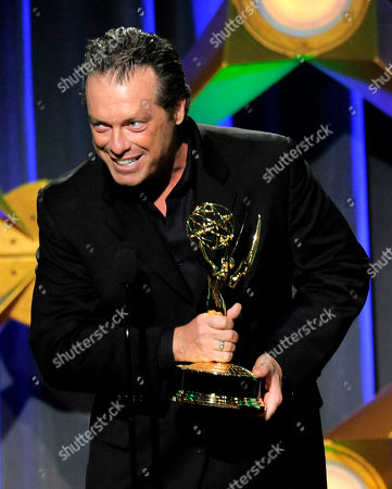 "Todd Newton accepts the game show host award for ""Family Game Night"" onstage at the 39th Annual Daytime Emmy Awards on HLN at the Beverly Hilton Hotel on in Beverly Hills, Calif"