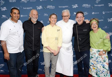 "Chefs, from left, Michael Mina, Hubert Keller, Mary Sue Milliken, Alain Ducasse, Rick Moonen and Susan Feniger attend ""The Grand Tasting"" during Vegas Uncork'd by Bon Appetit, presented by Chase Sapphire Preferred, at The Garden of The Gods, Caesars Palace, in Las Vegas"