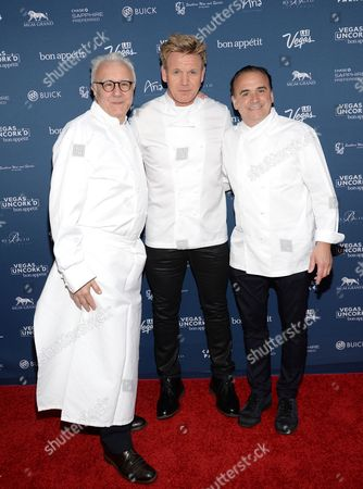 """Chefs Alain Ducasse, left, Gordon Ramsay and Jean-Georges Vongerichten attend """"The Grand Tasting"""" during Vegas Uncork'd by Bon Appetit, presented by Chase Sapphire Preferred, at The Garden of The Gods, Caesars Palace, in Las Vegas"""
