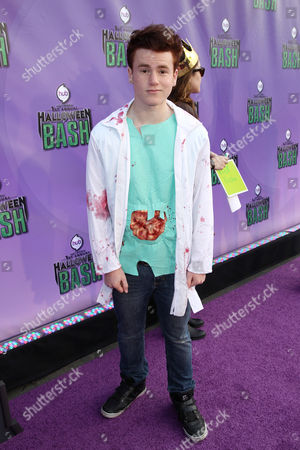"""Justin Tinucci arrives at """"Hub Network's First Annual Halloween Bash"""", at the Barker Hanger in Santa Monica, Calif. The star-studded special will be broadcasted on the Hub Network on Saturday Oct. 26, 2013"""