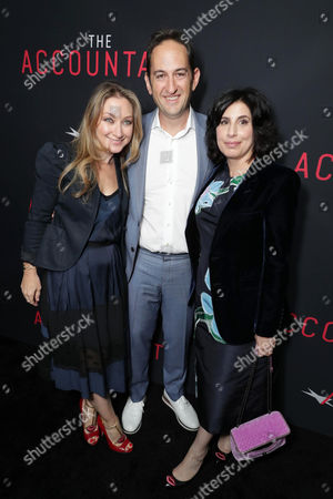 """Blair Rich, President of Worldwide Marketing for Warner Bros. Pictures, Greg Silverman, President of Creative Development and Worldwide Production for Warner Bros. Pictures, and Sue Kroll, President of Worldwide Marketing and Distribution for Warner Bros. Pictures, seen at the Los Angeles World Premiere of Warner Bros. Pictures' """"The Accountant"""" to benefit the American Film Institute at the TCL Chinese Theater, in Los Angeles"""