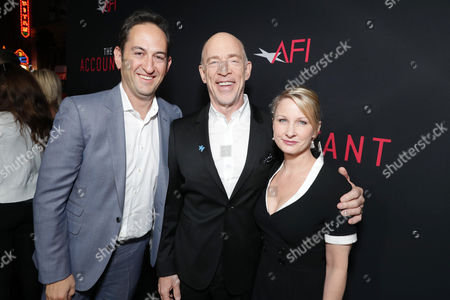 """Greg Silverman, President of Creative Development and Worldwide Production for Warner Bros. Pictures, J.K. Simmons and Michelle Schumacher seen at the Los Angeles World Premiere of Warner Bros. Pictures' """"The Accountant"""" to benefit the American Film Institute at the TCL Chinese Theater, in Los Angeles"""
