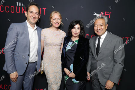Greg Silverman, President of Creative Development and Worldwide Productiat the TCL Chinese Theater on for Warner Bros. Pictures, Producer Lynette Howell Taylor, Sue Kroll, President of Worldwide Marketing and Distributiat the TCL Chinese Theater on for Warner Bros. Pictures, and Kevin Tsujihara, Chairman and CEO of Warner Bros., seen at the Los Angeles World Premiere of Warner Bros. Pictures' 'The Accountant' to benefit the American Film Institute at the TCL Chinese Theater on Mat the TCL Chinese Theater onday, in Los Angeles