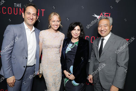 """Greg Silverman, President of Creative Development and Worldwide Production for Warner Bros. Pictures, Producer Lynette Howell Taylor, Sue Kroll, President of Worldwide Marketing and Distribution for Warner Bros. Pictures, and Kevin Tsujihara, Chairman and CEO of Warner Bros., seen at the Los Angeles World Premiere of Warner Bros. Pictures' """"The Accountant"""" to benefit the American Film Institute at the TCL Chinese Theater, in Los Angeles"""