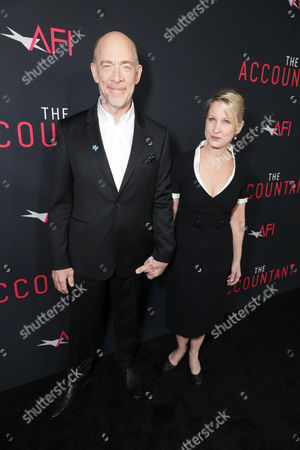 """J.K. Simmons and Michelle Schumacher seen at the Los Angeles World Premiere of Warner Bros. Pictures' """"The Accountant"""" to benefit the American Film Institute at the TCL Chinese Theater, in Los Angeles"""