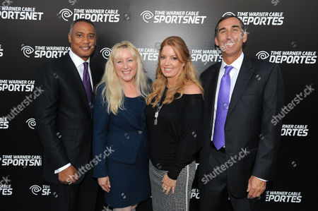 David Rone, President, TWC Sports, Melinda Witmer, Executive Vice President and Chief Video and Content Officer, Jeanie Buss, EVP, LA Lakers, and Mark Shuken, Senior Vice President and General Manager for TWC Sports Regional Networks, left to right, pose for a photo at the Time Warner Cable Sports launch event hosted by Time Warner Cable Sports, in Los Angeles